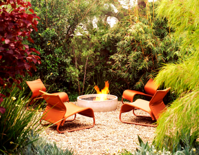Backyard Firepit with Tropical Plants