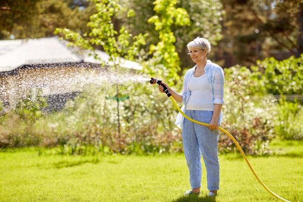 woman watering her yard