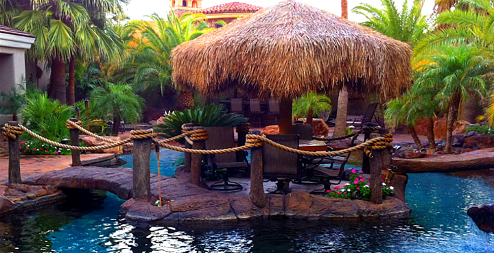 layered tropical landscape with poolside pergola